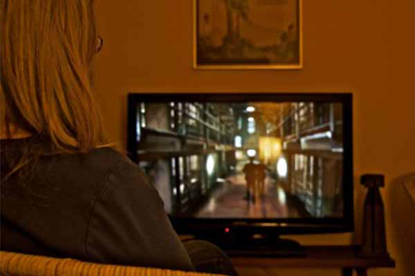 photo of a woman watching tv