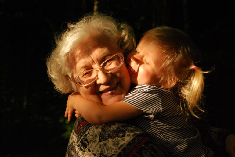 grandmother hugging a small child